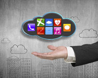 Man hand showing black cloud with colorful app icons Royalty Free Stock Photography