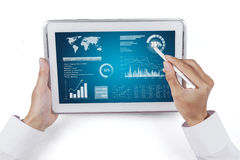 Man Hand Showing Chart on A Screen Stock Photo