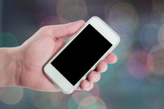 Man hand showing smart phone with isolated scree Stock Image