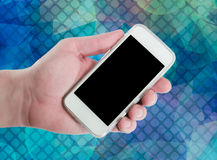 Man hand showing smart phone with  screen. On an abstract pale blurred circular bokeh lights background Stock Photo