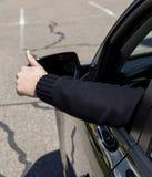Man hand showing thumb up through car`s window Royalty Free Stock Photos