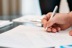 Man hand sign contract business career legal deal. Man hand signing contract closeup. business partnership and cooperation. deal closing and legal documents Stock Image