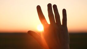 man hand silhouette sunlight. Muslim with man hand sun on light background. christian business love religion concept