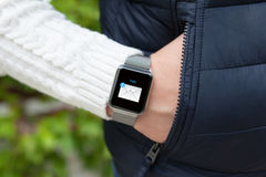 Man hand and smart watch with mail in the screen Royalty Free Stock Photos