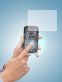 Man hand with smartphone and virtual screen Stock Photos