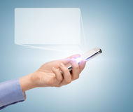 Man hand with smartphone and virtual screen Royalty Free Stock Photography