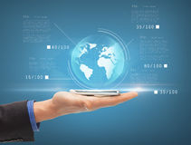 Man hand with smartphone and virtual sphere globe Stock Photo