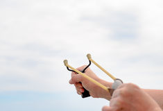 Man Hand Stretching Bands of his Stone Shooter Stock Photography