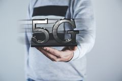 Man hand tablet with 5G royalty free stock image