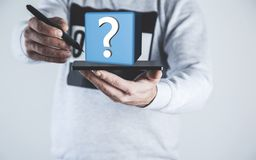 Man hand tablet with question mark stock photography