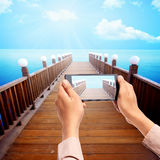 Man hand take picture of wooden pier using cellphone Stock Photos