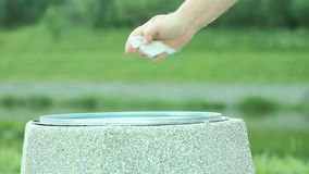 Man hand throwing out piece of paper in trash can. 1080p stock footage