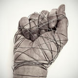 Man hand tied with wire. As a symbol of oppression or repression, on a white background Stock Image