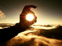 Free Man Hand Touch Sun. Misty Daybreak In A Beautiful Hills. Royalty Free Stock Image - 75684446