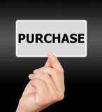 Man hand touching button purchase keyword. Stock Photo