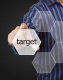 Man hand touching button target keyword. Royalty Free Stock Photo