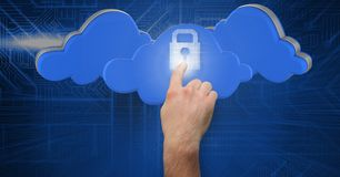 Man hand touching futuristic lock pad with cloud interface in background Royalty Free Stock Photo