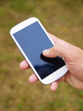 Man hand touching screen on smart phone 2 Royalty Free Stock Photo