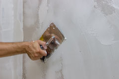Man hand with trowel plastering a wall 3 Stock Photography