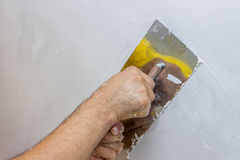 Man hand with trowel plastering a wall 4 Stock Photography
