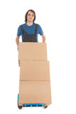 Man with hand truck boxes Stock Photo