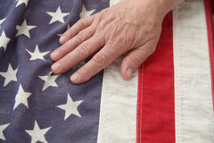 Man with hand on USA flag Stock Photo