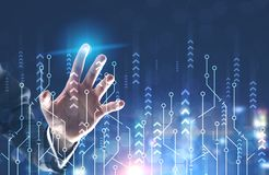 Man hand using growth interface. Hand of unrecognizable businessman wearing suit and shirt using growth interface over dark blue background. Concept of business stock image