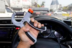 Man hand using a hand-held exercise machine in during a traffic. Jam, Man hand is exercising by hand-held machine Stock Photos