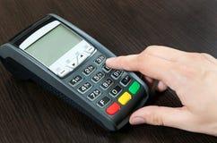 Man hand using payment terminal Stock Photos
