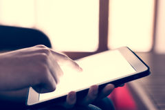 Man hand using white tablet at home royalty free stock photography