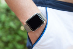 Man hand with a Watch in his pocket shorts Royalty Free Stock Image