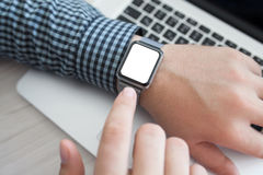Man hand and Watch with isolated screen Stock Image