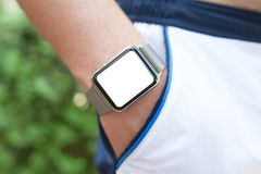 Man hand and Watch with isolated screen in pocket shorts Stock Photos