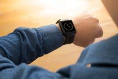 Man Hand wearing elegant smartwatch stock photo