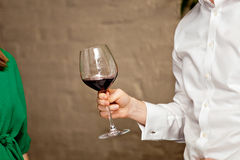 Man hand with wine glass royalty free stock photos