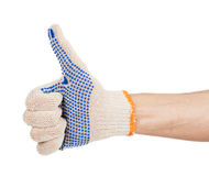 Man hand in work glove with thumb up Stock Images