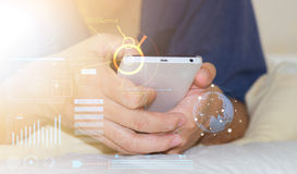 Man hand working on  smart phone with digital layer. Stock Photos