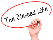 Man Hand writing The Blessed Life  with black marker on visual s Royalty Free Stock Photography