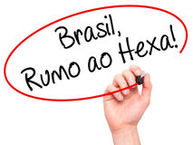 Man Hand writing Brasil, Rumo ao Hexa! with black marker on visu Royalty Free Stock Photography