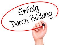 Man Hand writing Erfolg Durch Bildung  (Success Through Training Royalty Free Stock Photo