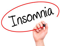 Man Hand writing Insomnia with black marker on visual screen. Stock Photos