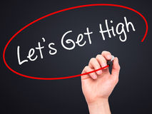 Man Hand writing Let's Get High with black marker on visual scre Royalty Free Stock Image