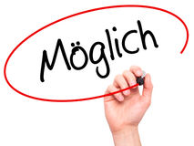 Man Hand writing Moglich (Possible in German) with black marker Royalty Free Stock Photos