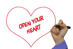 Man Hand writing Open your heart with marker on transparent wipe. Board. Isolated on white Stock Images