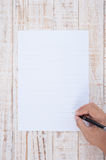 Man hand writing Paper  on wood table for text and background Stock Photography