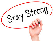 Man Hand writing Stay Strong with black marker on visual screen. Royalty Free Stock Photos