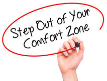 Man Hand writing  Step Out of Your Comfort Zone with black marke Royalty Free Stock Image