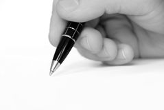 Man hand writing on white paper Royalty Free Stock Images