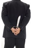 Man with handcuff and knife Royalty Free Stock Photography
