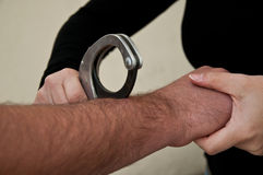Man handcuffed. Man with hand handcuffed back closeup Stock Images